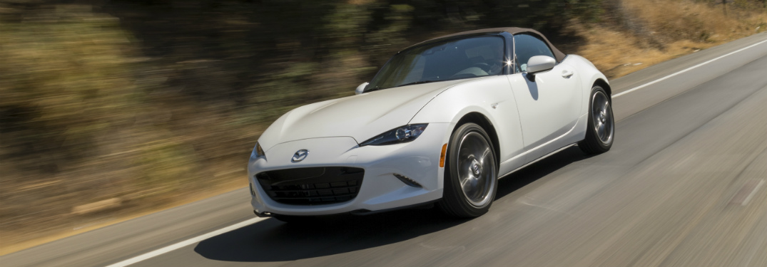 white 2019 Mazda MX-5 Miata with brown soft-top roof