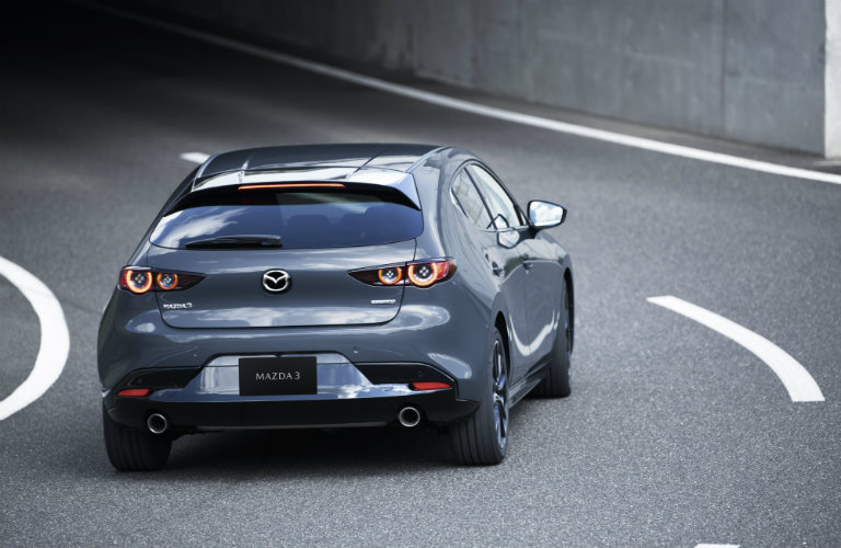 2019 Mazda3 hatchback driving on a racetrack