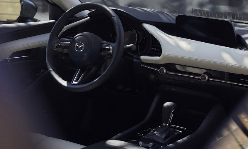 Dashboard and steering wheel in the 2019 Mazda3 sedan