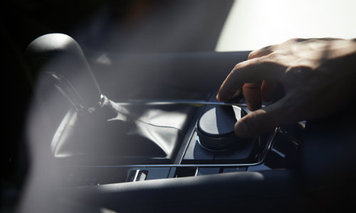 Hand touching button in 2019 Mazda3 sedan