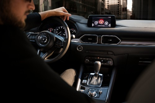 A man behind the wheel of the 2019 Mazda CX-5 Signature
