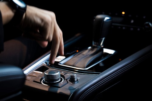 A person touching the center console in the 2019 Mazda CX-5 Signature