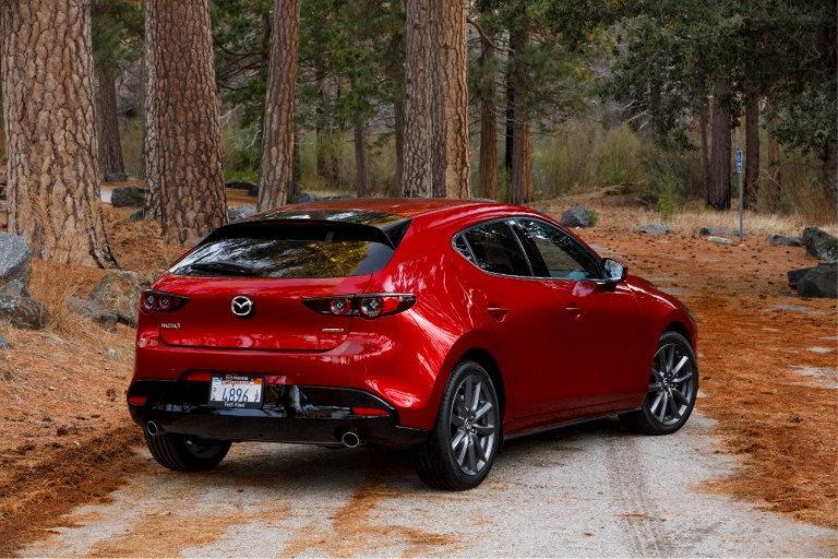 View of the 2019 Mazda3 hatchback in the woods