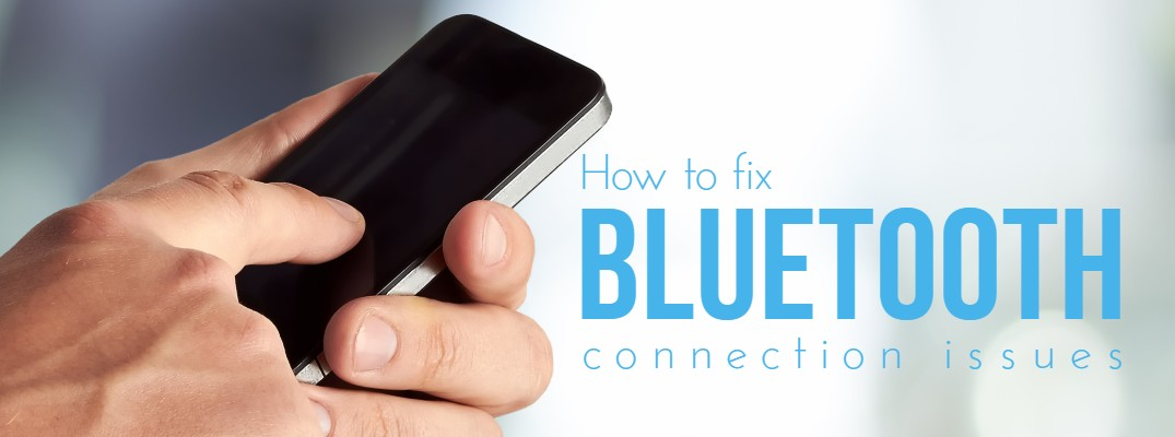 "An image of a man holding a phone with text that says ""how to fix Bluetooth connection issues"""