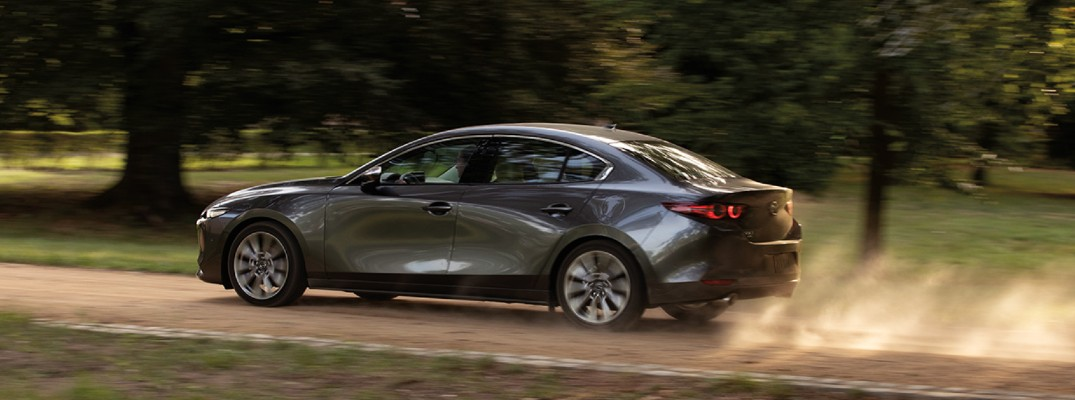 2020 Mazda 3 sedan driving on a sunny day