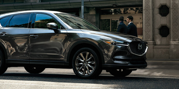 Side view of gray metallic 2020 Mazda CX-5
