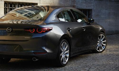 Rear view of grey 2021 Mazda3