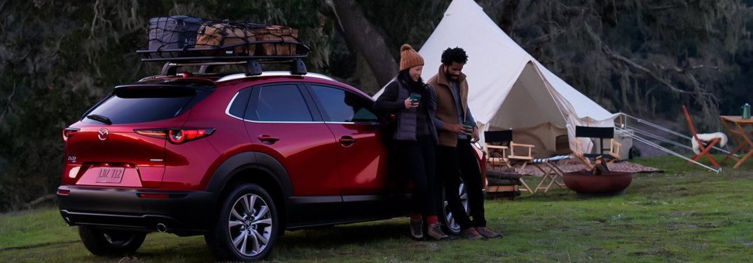 A couple camping with a 2021 Mazda CX-30