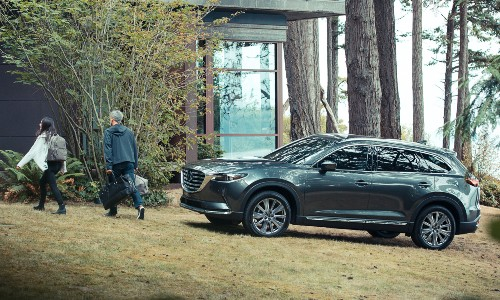2021 Mazda CX-9 parked on grass outside forest home
