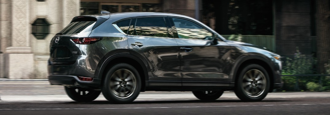 2021 Mazda CX-5 green side view parked in front of building