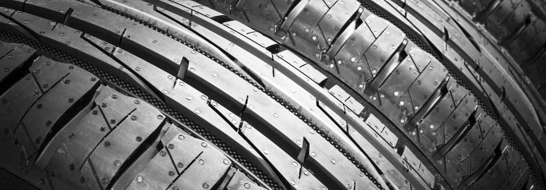 close up of multiple car tires