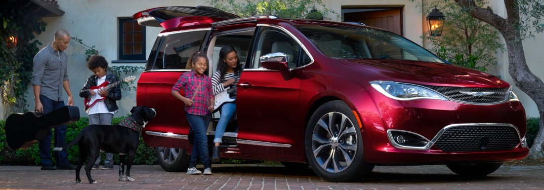 2019 Chrysler Pacifica red side view with family