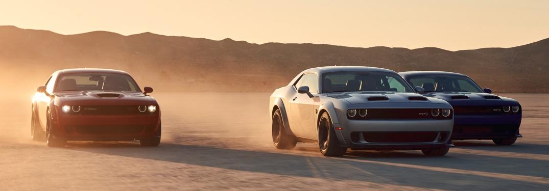 2019 Dodge Challenger Hellcat models racing in the desert