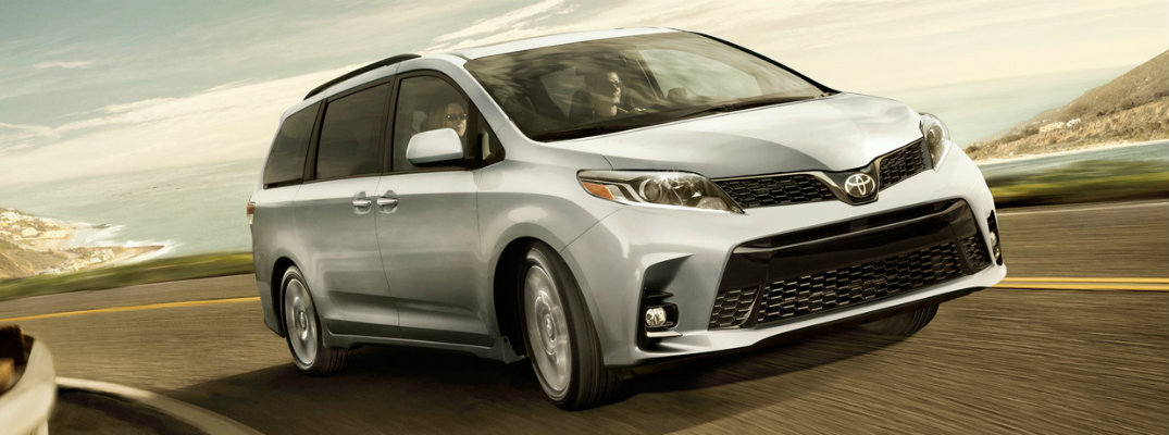 Front view of 2019 Toyota Sienna driving on country road