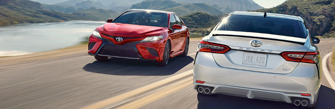 2019 Toyota Camry passing another Camry on the road