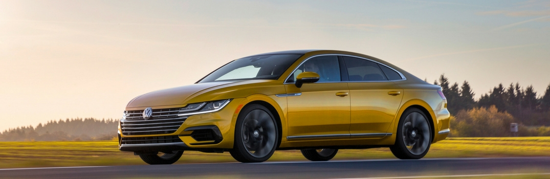 2019 VW Arteon in yellow metallic color options with a sunset background