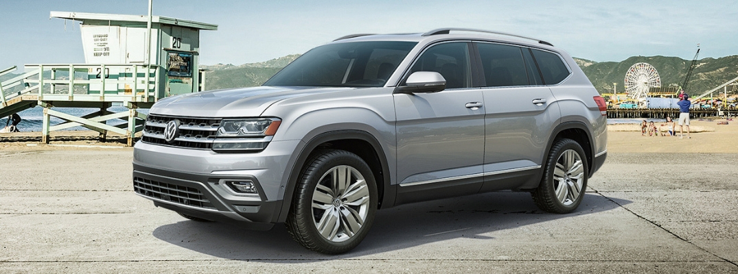 Silver 2019 Volkswagen Atlas parked in front of beach