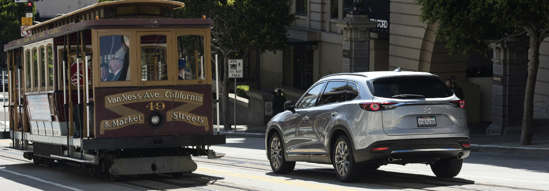 2016 Mazda CX-9 on road next to trolley