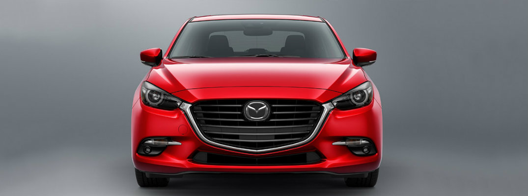 Front view of red 2018 Mazda3 on gray background