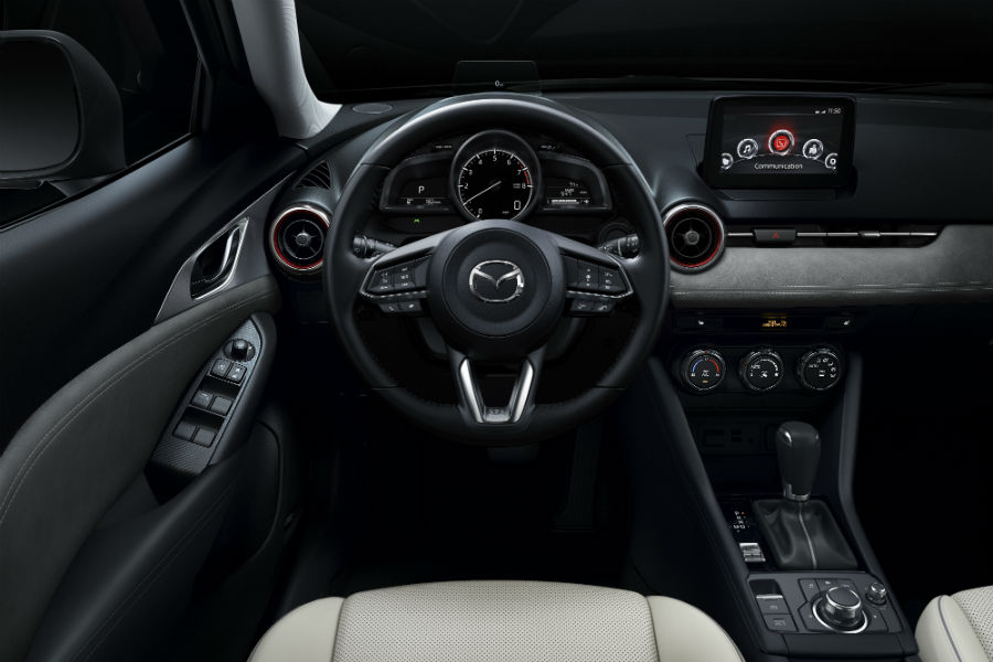 An interior photo of the driver's cockpit of the 2019 Mazda CX-3 and its new technology.