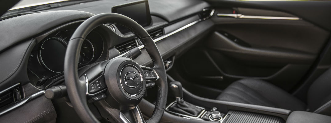 An interior photo showing the various upholstery and accent materials used in the 2018 Mazda6.