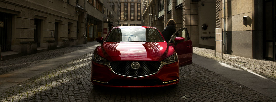 A head-on photo of the 2018 Mazda6 parked in in an alley.