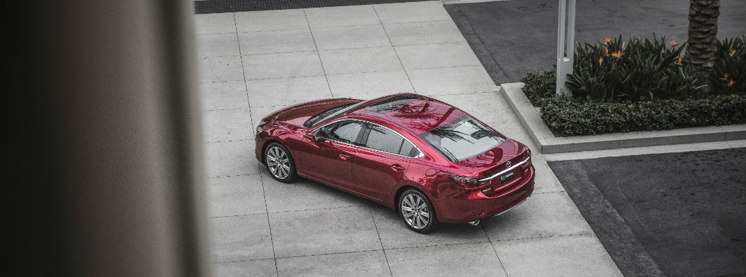 An overhead photo of the 2018 Mazda6 parked between buildings.
