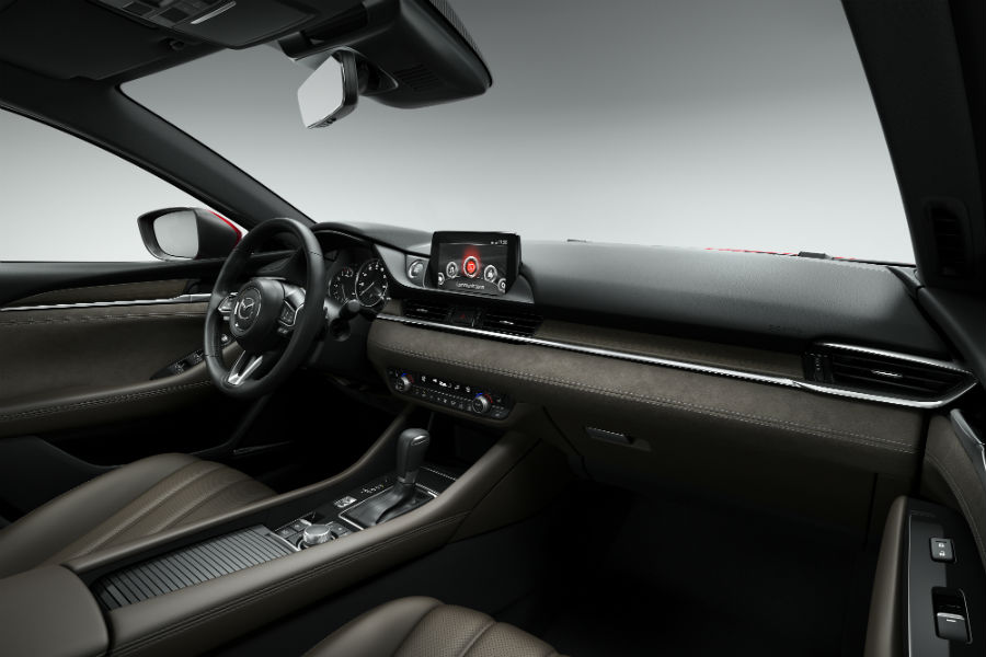 An interior photo of the dashboard in the 2018 Mazda6.