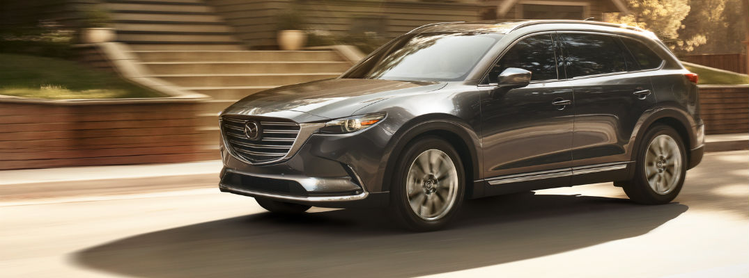 A front left quarter photo of the 2019 Mazda CX-9 on the road.