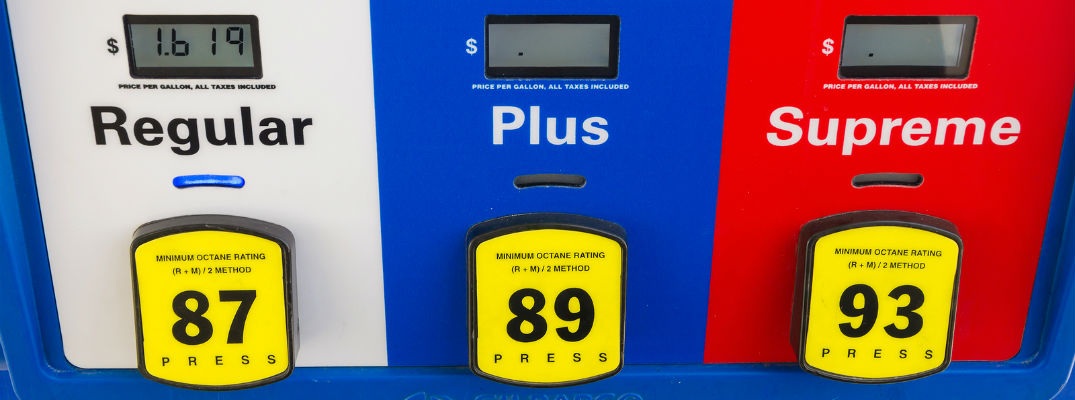 A stock photo of a gas pump with several grades of gasoline.