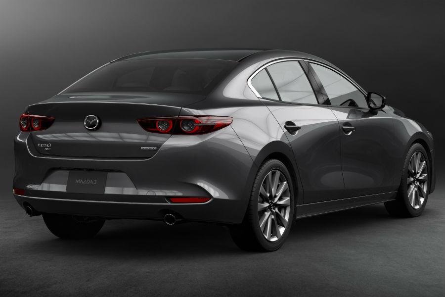 A rear right quarter photo of the 2019 Mazda3 sedan.