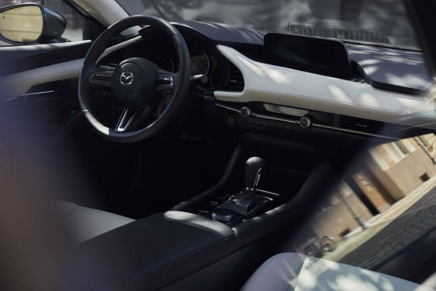 An interior photo of the 2019 Mazda3 sedan.