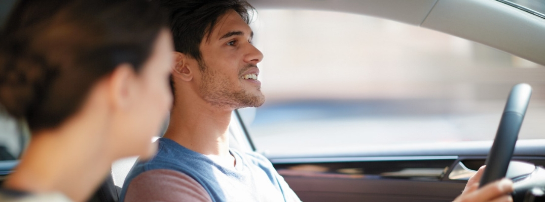 Male Driver Smiling With Woman