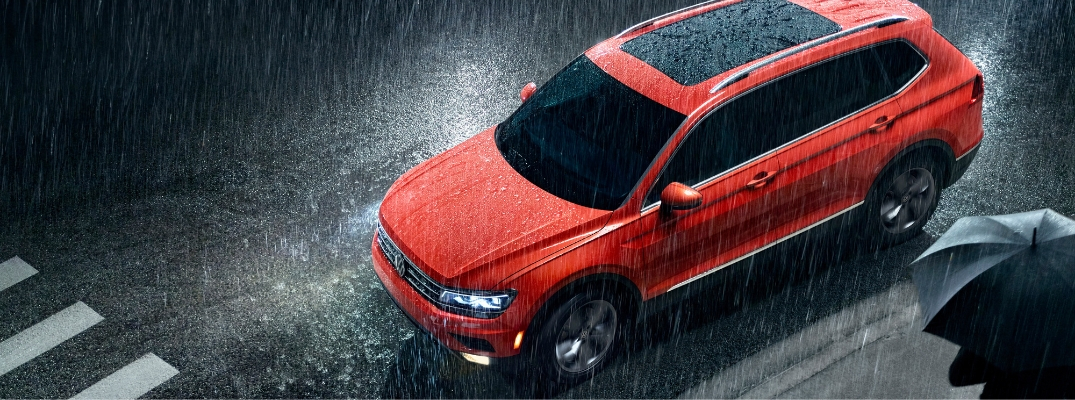 Orange 2019 VW Tiguan in rain