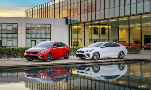 2019 Kia Forte models outside a fancy dealership
