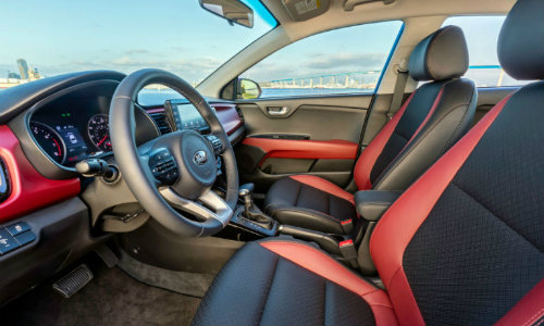 2018 Kia Rio front seating interior side shot upholstery and steering wheel