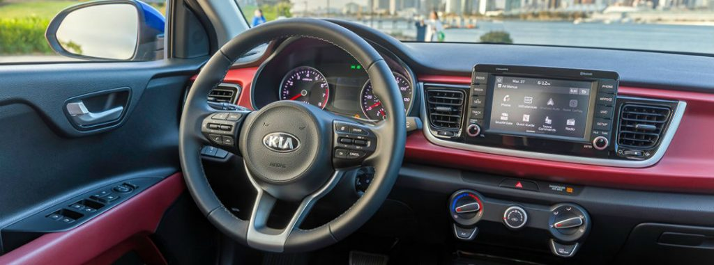 Kia Rio Interior Front Drivers Seat View Of Steering Wheel Dashboard Transmission And Cityscape Background Out Of The Windshield Glass O X on Kia Sorento Windshield Parts
