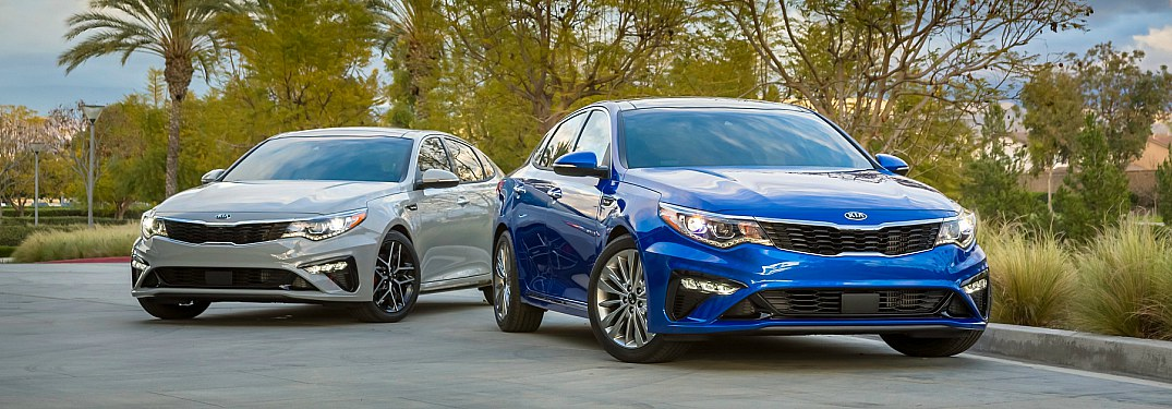 2019 Kia Optima white and blue side by side
