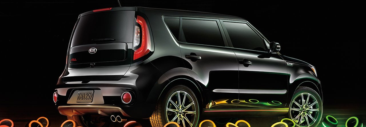 2019 Kia Soul black side view surrounded by speakers