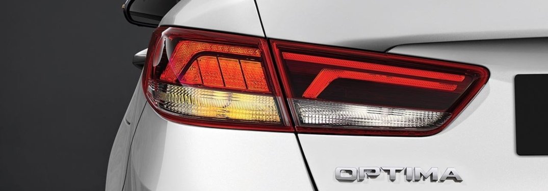 2019 Kia Optima white back view close up on emblem
