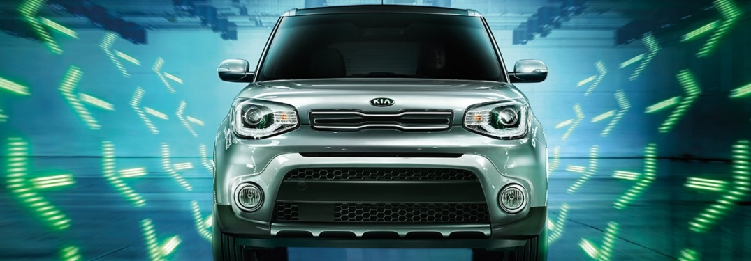 2019 Kia Soul front view with green arrows surrounding