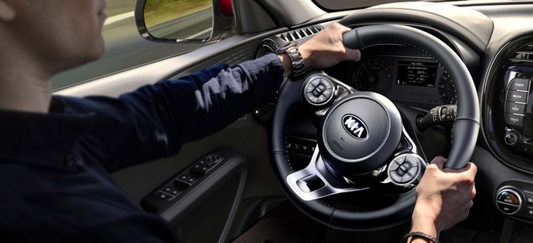 2020 Kia Soul with man holding steering wheel