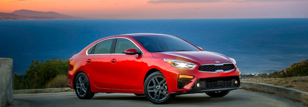2019 Kia Forte red side view in front of a sunset