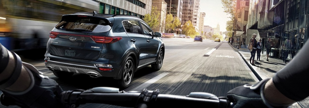 2020 Kia Sportage blue rear view from a bicycle