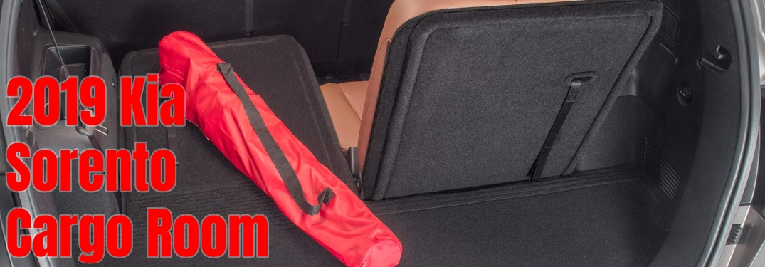 2019 Kia Sorento with cargo mat and a red folding chair