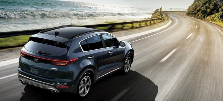 2020 Kia Sportage blue back view on the road
