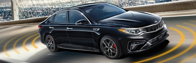 2019 Kia Optima in black with driver assist features
