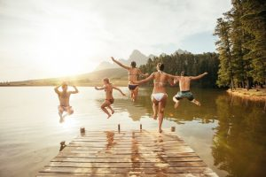 Friends Jumping Into Lake