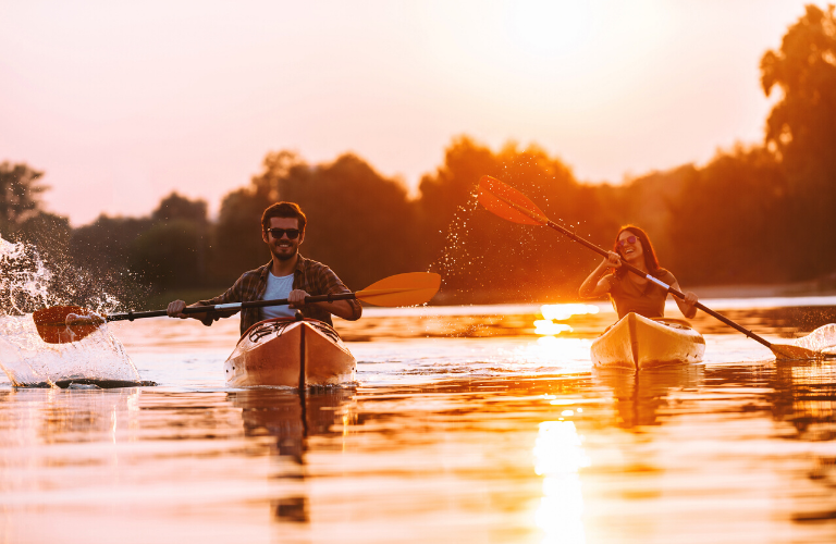 Couple paddling on the water