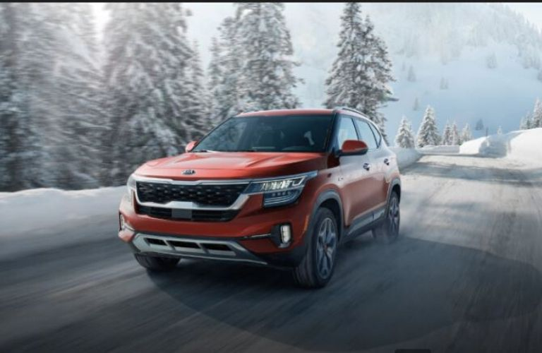 2021 Kia Seltos driving on the road front view